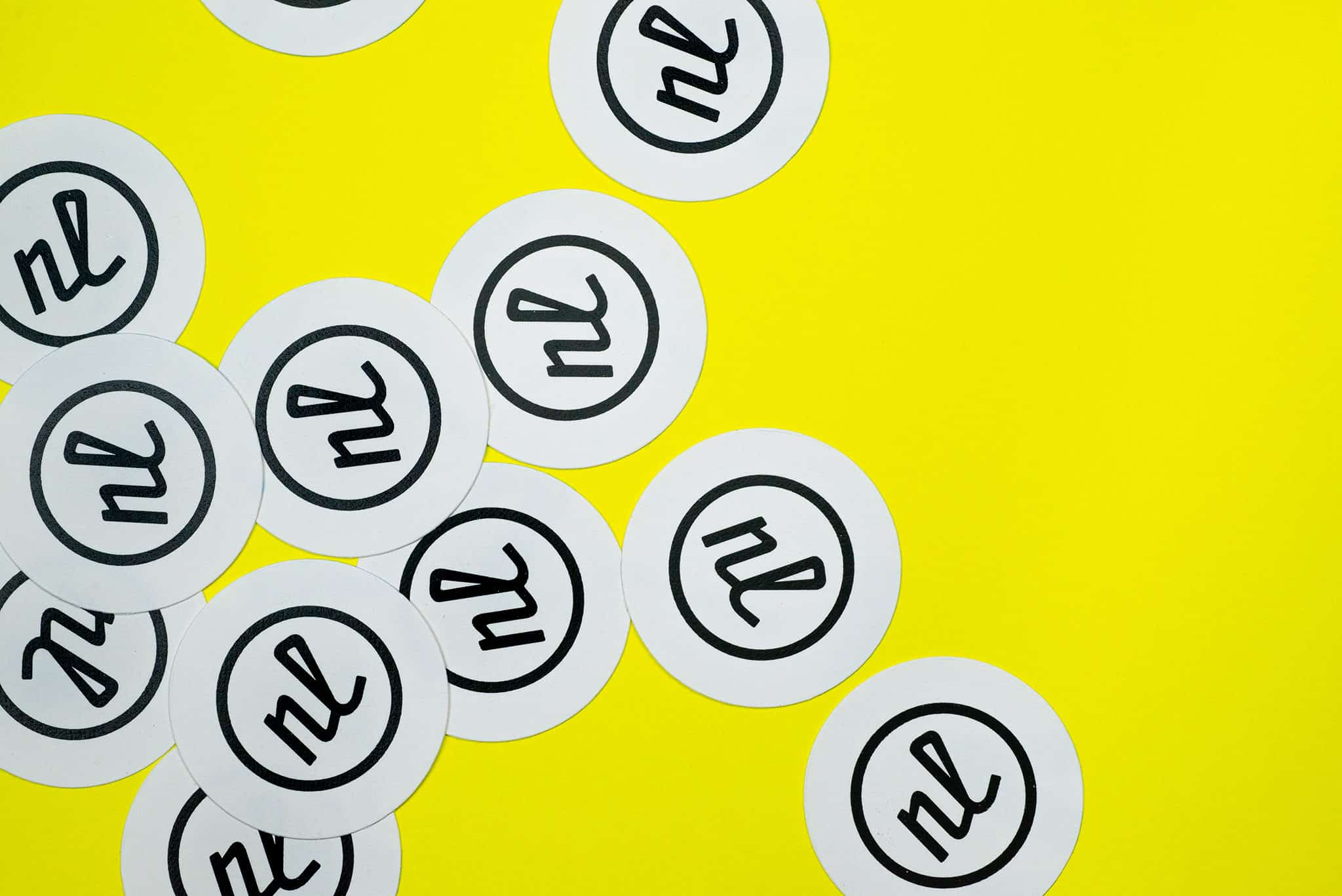Letterpress printed stickers for Nathan Lindstrom Photography | Designed by Field of Study: A branding and graphic design consultancy | Houston TX | Jennifer Blanco & John Earles