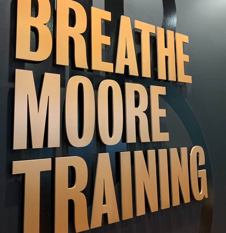 Anodized aluminum and black vinyl signage for Breathe Moore Training | Designed by Field of Study: A branding and graphic design consultancy | Houston TX | Jennifer Blanco & John Earles