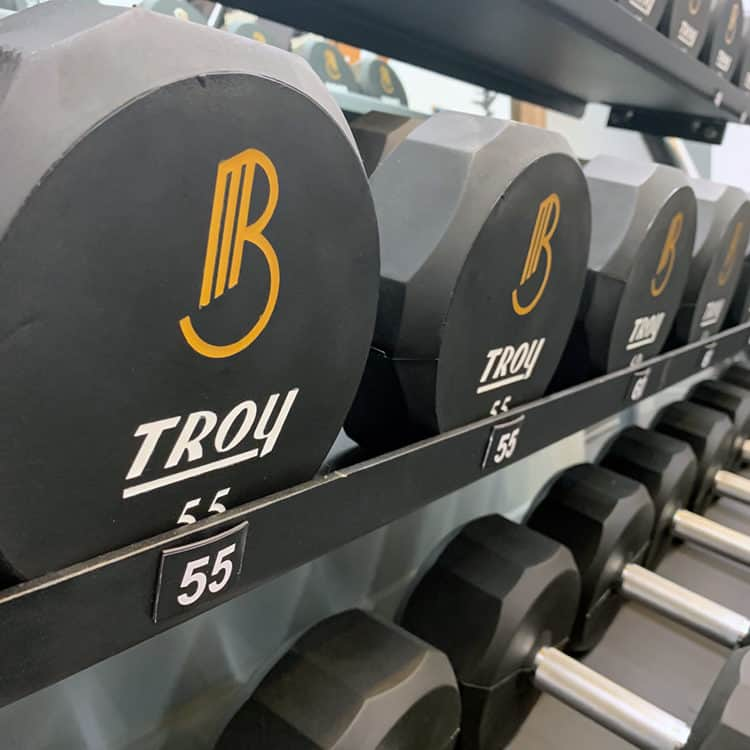 Custom logo dumbbells for Breathe Moore Training | Designed by Field of Study: A branding and graphic design consultancy | Houston TX | Jennifer Blanco & John Earles