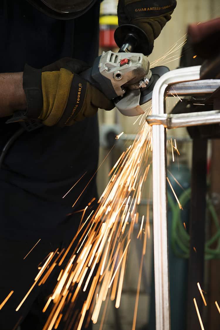 FMW|FabLab worker grinding